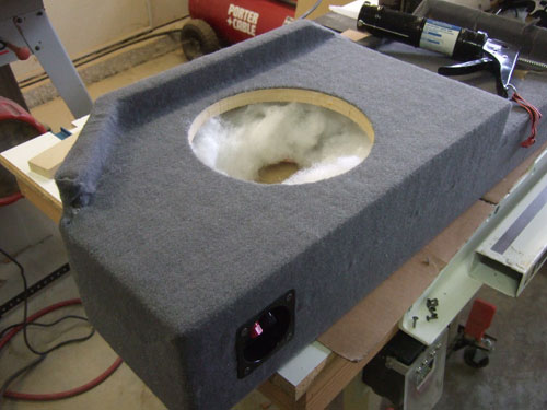 Custom subwoofer enclosure - bottom view with carpet and stuffed with polyfill